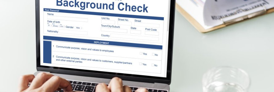 Business man searches online for a background check company.